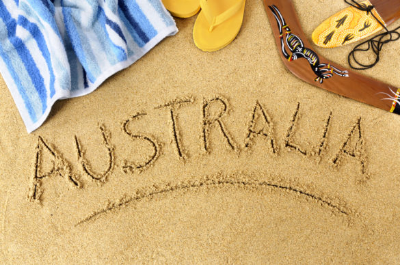Australia beach background with boomerang, towel and flip flops.