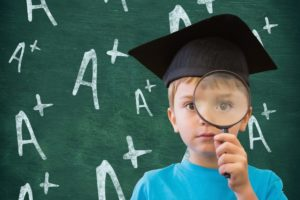 afterpay-share-price-forecast-apt-Boy in graduation cap holding magnifying glass against A positive sign in background