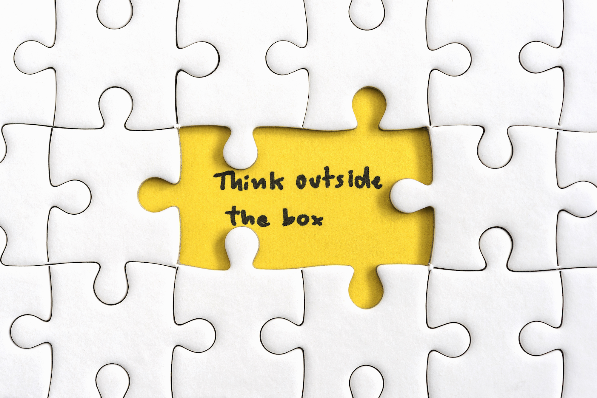 asx-snl-small-cap-asx Jigsaw puzzle piece with two missing and hand writing letters word think outside the box, Quotes business concept