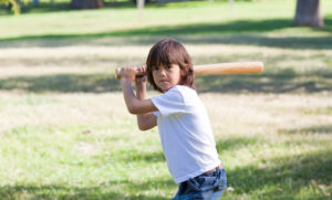 challenger-share-price-asx-cgf-asx-200-xjo-Portrait of adorable child playing baseball