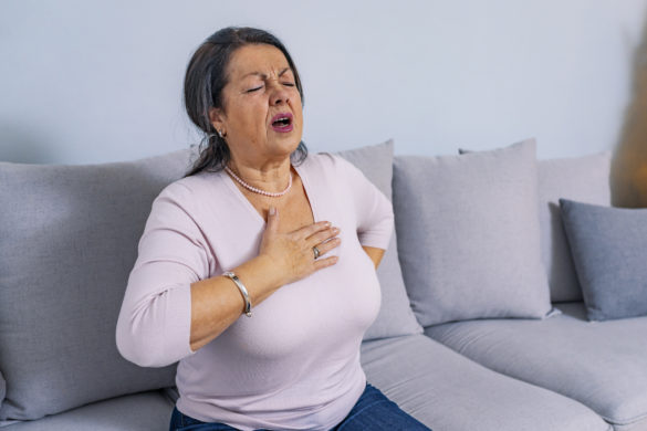 estia-share-price-image-Mature woman holds her heart. Woman having a pain in the heart area. Heart Attack. Painful Chest. Health Care, Medical Concept. High Resolution.
