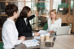 Rude businessman firing upset frustrated businesswoman telling to leave meeting