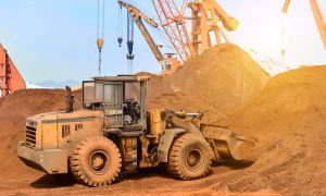 newcrest-mining-asx-ncm-ncm-share-price-Close-up of a construction site excavator