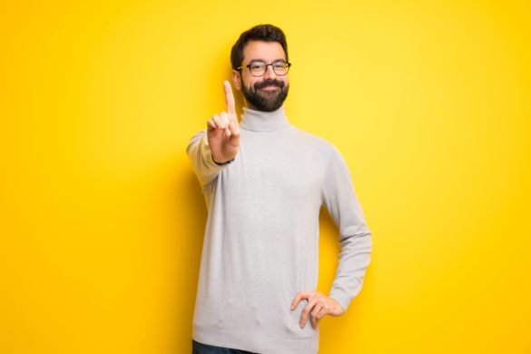 asx etfs ivv. Man with beard and turtleneck showing and lifting a finger