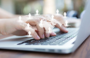 frontier markets like Africa shown on closeup of business woman hand typing on laptop keyboard