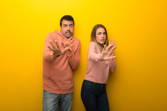 asx 200. image shows couple look scared or fearful at the camera