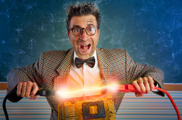 pro medicus. image shows a man wearing a bow tie holding electrical cables over a piece of software. he's being electrified.
